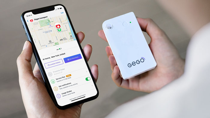 Hands holding an iphone with screen displaying map with location indicator, next to a white GEGO tracking device